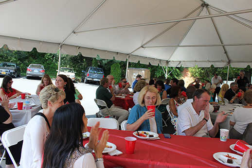 Employees and guests enjoy lunch during a speech by SHINE president Jeff Thomas