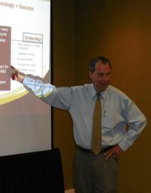 Bob Bowers presenting the APiMTM